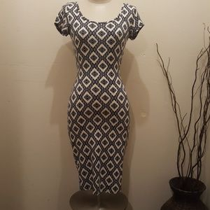 Papaya beautiful Creme and Black dress,Preloved